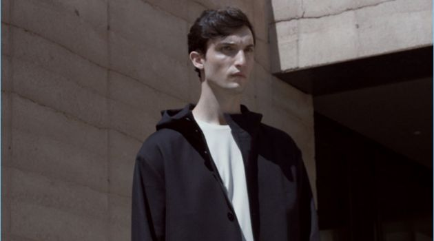 Standing tall, Max Von Isser wears a COS oversize jersey t-shirt with a parka and cotton-linen trousers.