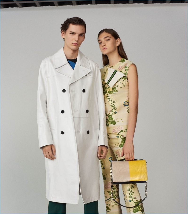 Calvin Klein 205W39NYC goes oversize with a leather trench coat $6,450. Barneys New York styles it with the label's stripe-appliquéd wool trousers $850.