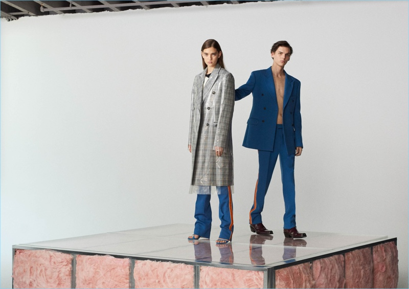 Blue provides a bold color for Calvin Klein 205W39NYC's wool double-breasted sport coat $1,895 and stripe-appliquéd virgin wool trousers $850. Take your look to the next level with Calvin Klein 205W39NYC's Spazzolato leather Chelsea boots $1,095.