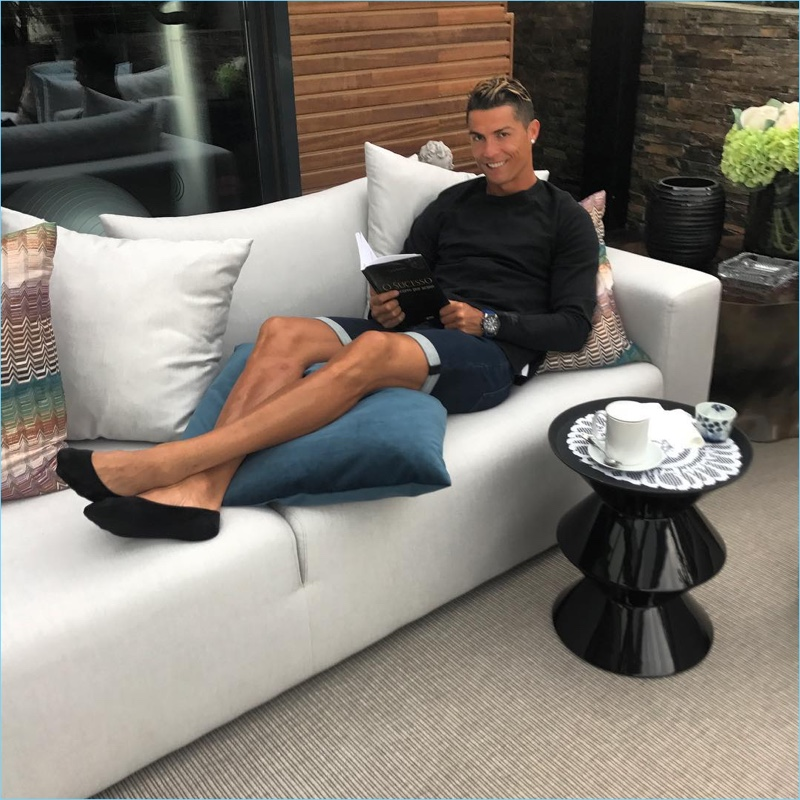 Relaxing, Cristiano Ronaldo rocks a pair of his CR7 denim shorts.