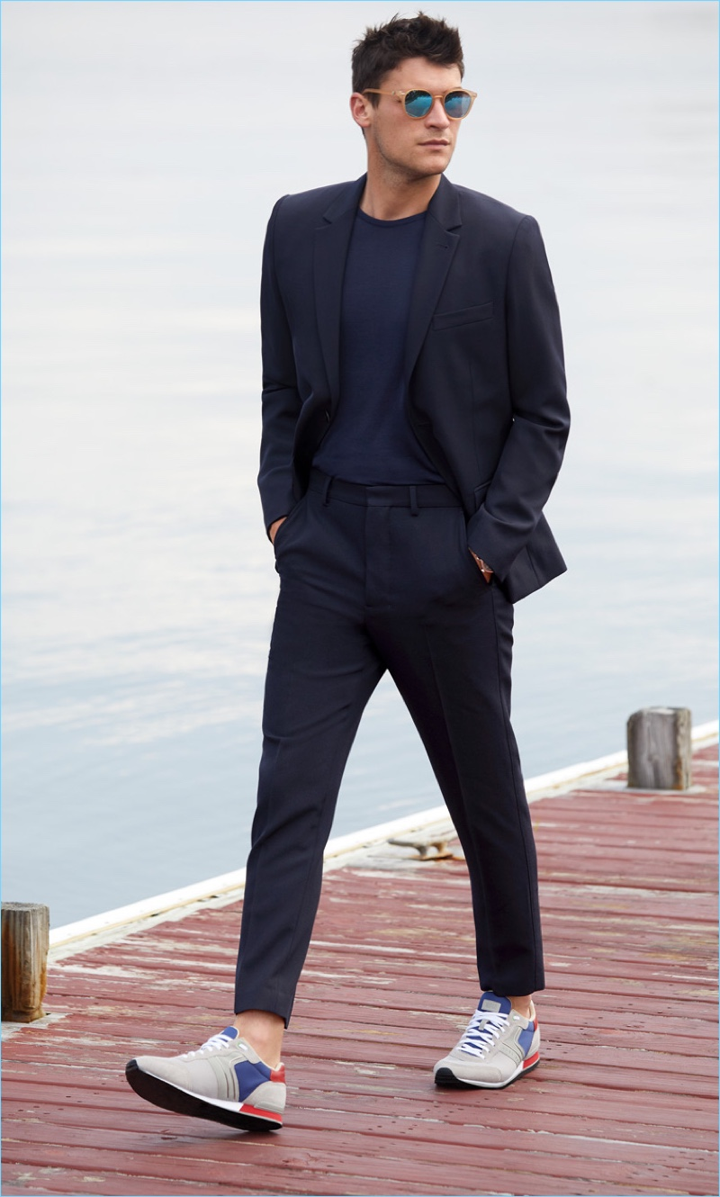 Made in the Shade: Miles Garber wears a Theory suit jacket $435 and trousers $180 with an A.P.C. sweater. He also sports Le Specs sunglasses and HUGO sneakers.