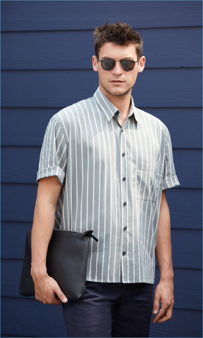 Front and center, Miles Garber wears a Vince striped shirt $225 with A.P.C. pants $275. Oliver Peoples sunglasses $455 and an Uri Minkoff leather pouch $175 complete the look.