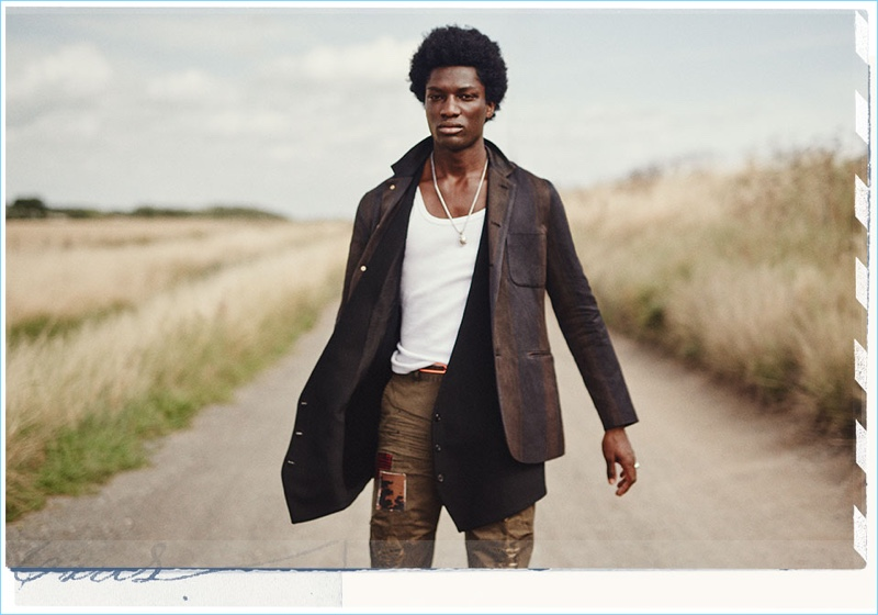 Front and center, Josue Comoe sports an Uma Wang jacket with an Ann Demeulemeester waistcoat. Josue also rocks a Gold tank and Squared2 trousers.