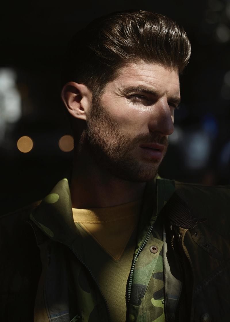Ryan wears jacket Belstaff, camouflage jacket Spitalfield Market, and sweatshirt Bay Meadows.