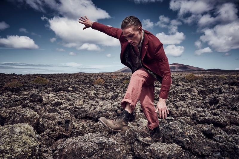 Tom wears blazer Farah, shirt Belstaff, vest Montcler, trousers Bottega Veneta, and boots Weekday.