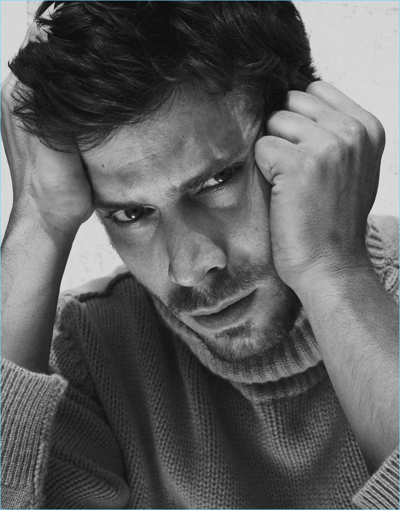 Ready for his close-up, François Arnaud sports a Stella McCartney sweater.