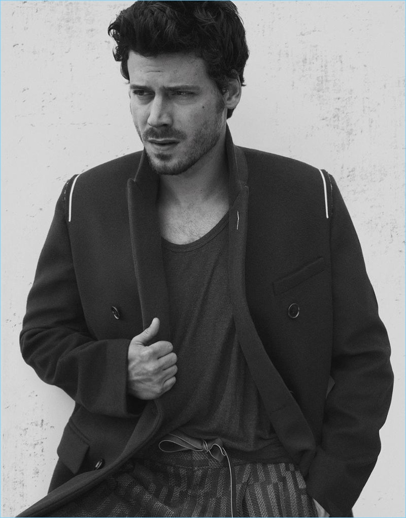 Connecting with Interview magazine, François Arnaud wears a Dior Homme coat with a T by Alexander Wang tank and Ermenegildo Zegna trousers.