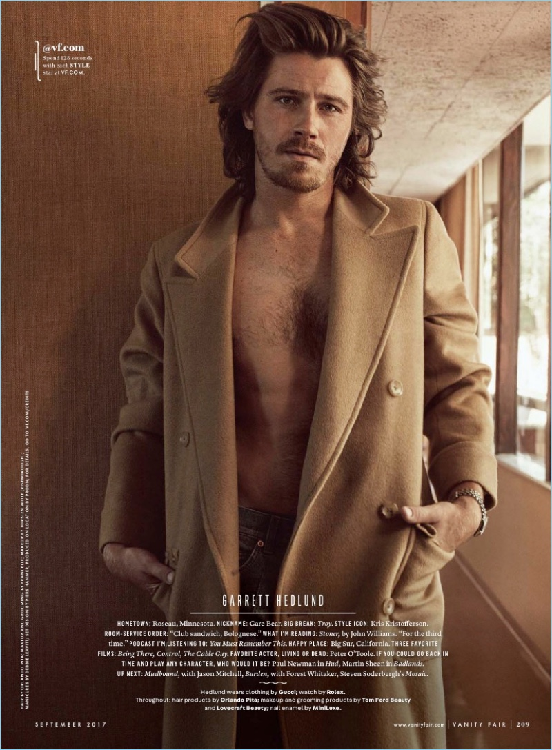 Garrett Hedlund goes shirtless in jeans and a camel coat from Gucci.