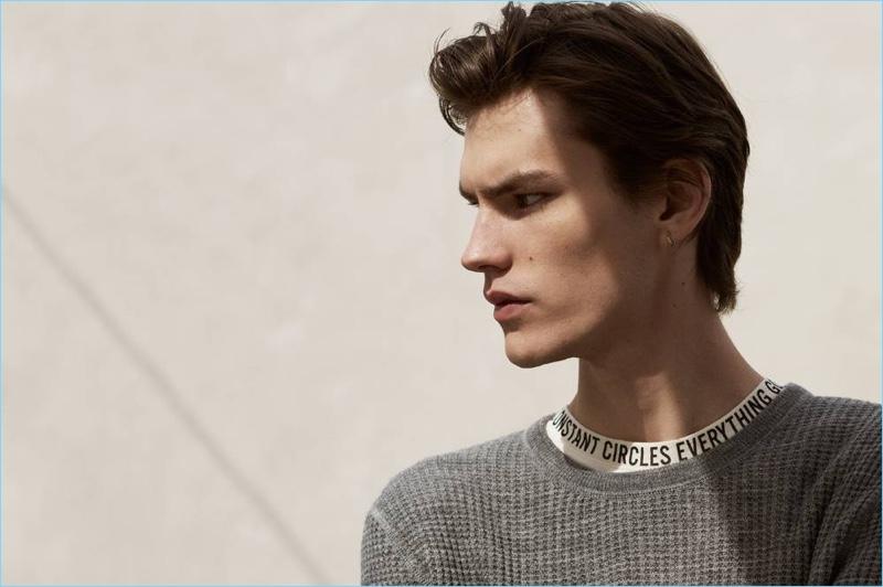 New Beginnings: Elias de Poot wears a textured wool-blend sweater $34.99 and wide-cut t-shirt $14.99 from H&M.