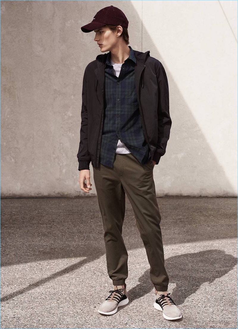 Going sporty, Elias de Poot wears a windproof jacket $49.99, cotton joggers $29.99, corduroy cap $12.99, shirt $24.99, and suede sneakers $69.99.