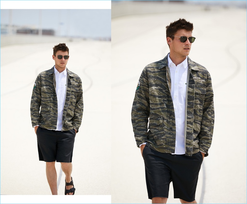 Solids collide with an easy print for this outfit. Miles Garber models a Current/Elliott camouflage jacket $278.60 with a Lacoste oxford shirt $98. He also wears RVCA shorts $45, Birkenstock sandals $35, and Ray-Ban sunglasses $150.