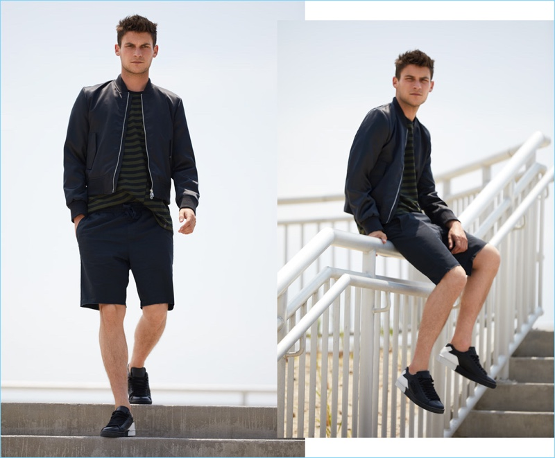Layering for brisk weather, Miles Garber wears a MKI souvenir jacket $131.60 and Rag & Bone striped tee $125. RVCA shorts $45 and Kenzo sneakers $215.20 complete his look.
