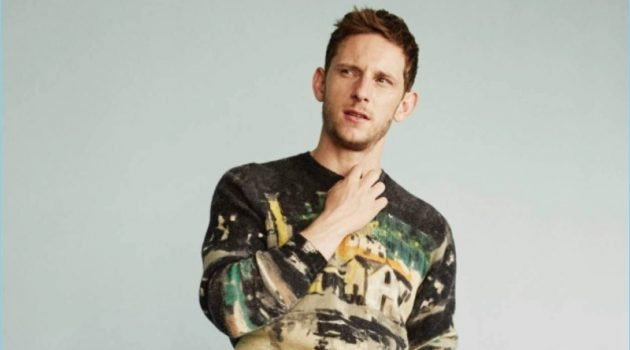 Actor Jamie Bell dons a Prada sweater with Dries Van Noten trousers.