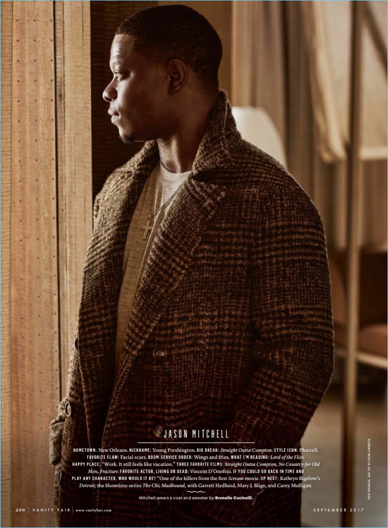 Jason Mitchell wears a coat and sweater by Brunello Cucinelli.