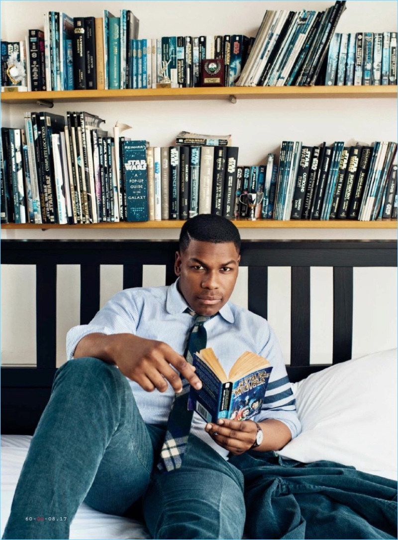 Relaxing, John Boyega sports a Kidos suit with a Thom Browne shirt and Alexander Olch tie.