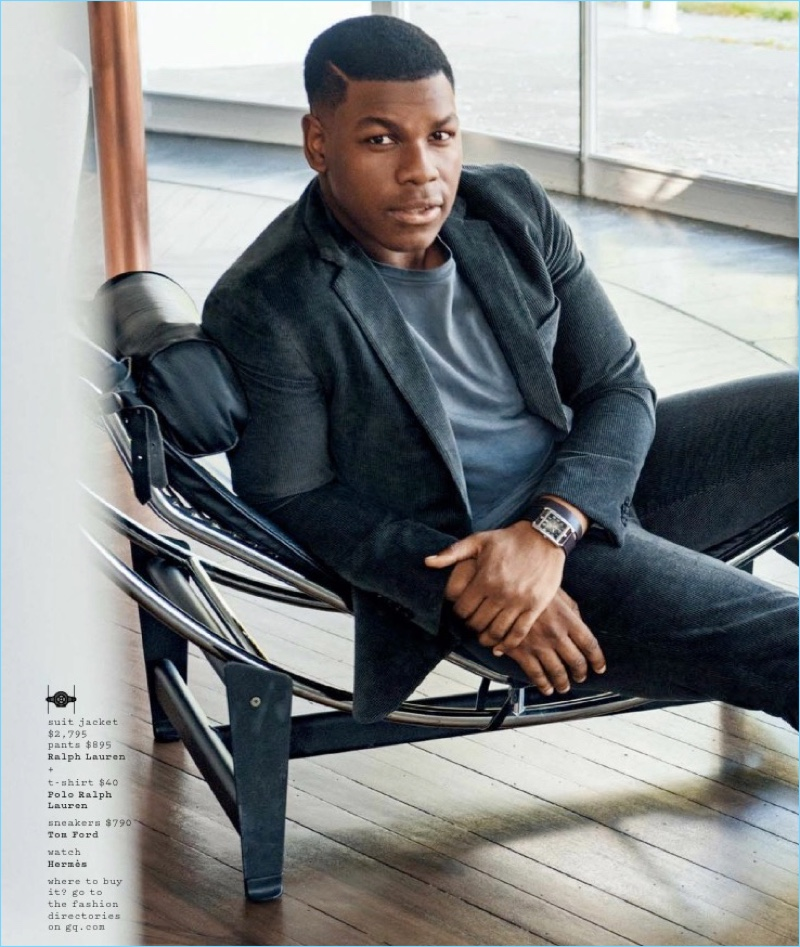 Connecting with GQ, John Boyega wears a Ralph Laurent suit jacket and pants with a POLO Ralph Lauren t-shirt and Tom Ford sneakers.