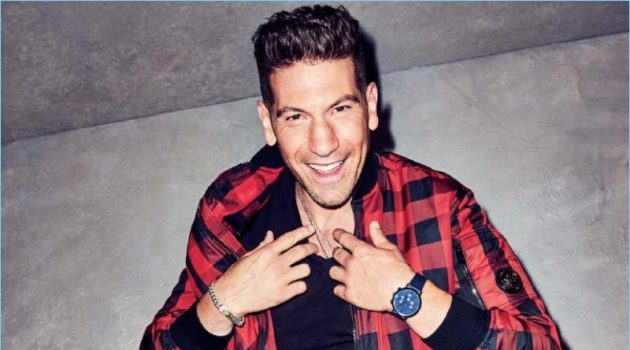 All smiles, Jon Bernthal wears a buffalo check jacket and leather pants by Versace. Bernthal also dons an Armani Exchange t-shirt and Saturdays NYC sneakers.