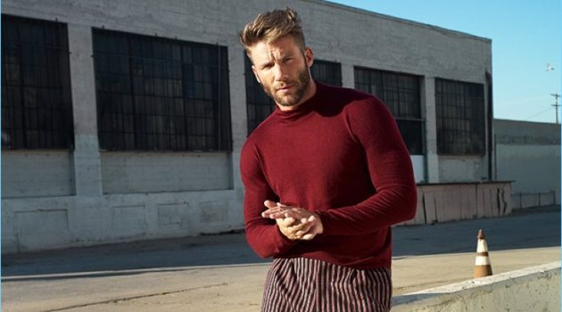 Making a case for red, Julian Edelman wears a Giorgio Armani sweater, Gucci trousers, and Dries Van Noten wingtip brogues.