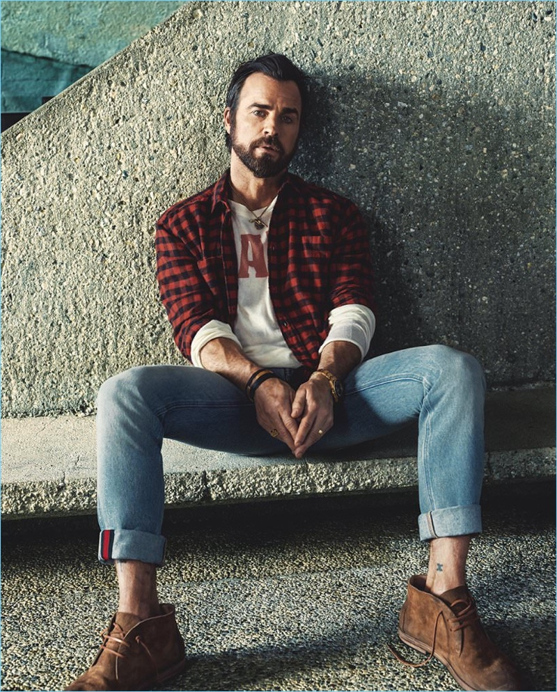 Bjorn Iooss photographs Justin Theroux in a Saint Laurent buffalo check shirt with Gucci jeans and a t-shirt by The Elder Statesman. Theroux also sports Marséll washed-suede chukka boots.