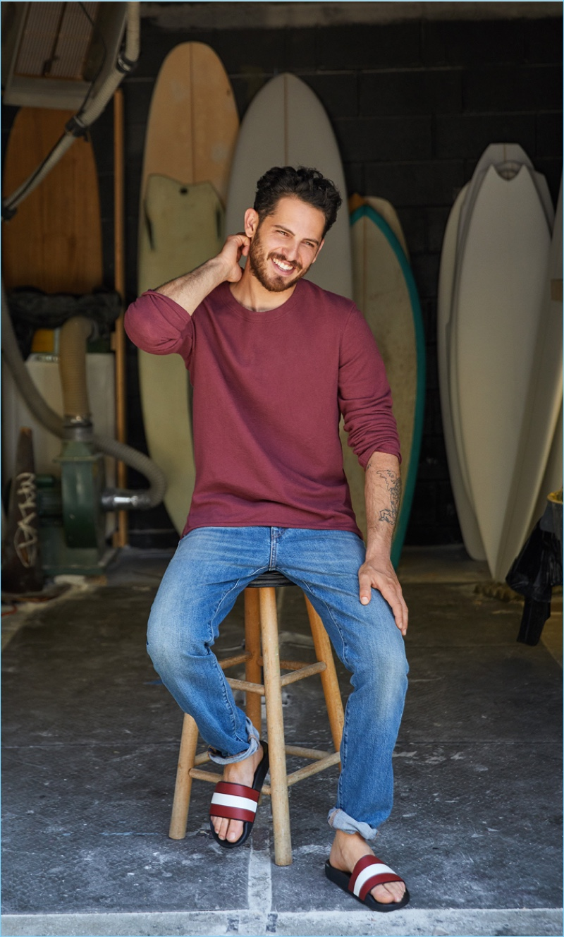 Play Around: Go casual and pair a Levi's Made & Crafted long-sleeve tee $118 and denim jeans $198 with Bally slides $175.