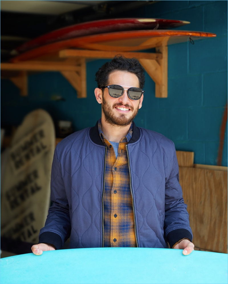 Add & Subtract: Layer the staples with a Levi's Made & Crafted quilted bomber jacket $298. East Dane styles it with a Levi's Red Tab worker shirt $70 and striped tee $35. Complete the look with Ray-Ban sunglasses $195.
