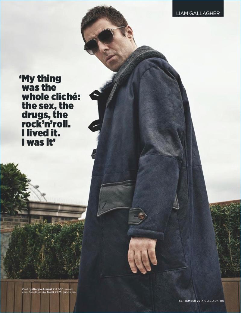 Dressing for winter, Liam Gallagher sports a Giorgio Armani coat with Gucci sunglasses.