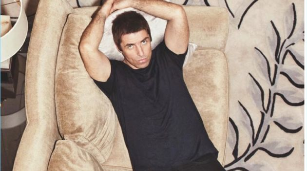 Relaxing, Liam Gallagher wears a Sunspel t-shirt with Levi's jeans.