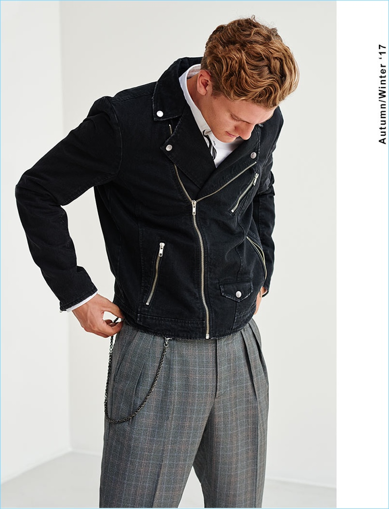 Model Mikkel Jensen sports pleated check trousers with a biker jacket from Reserved.