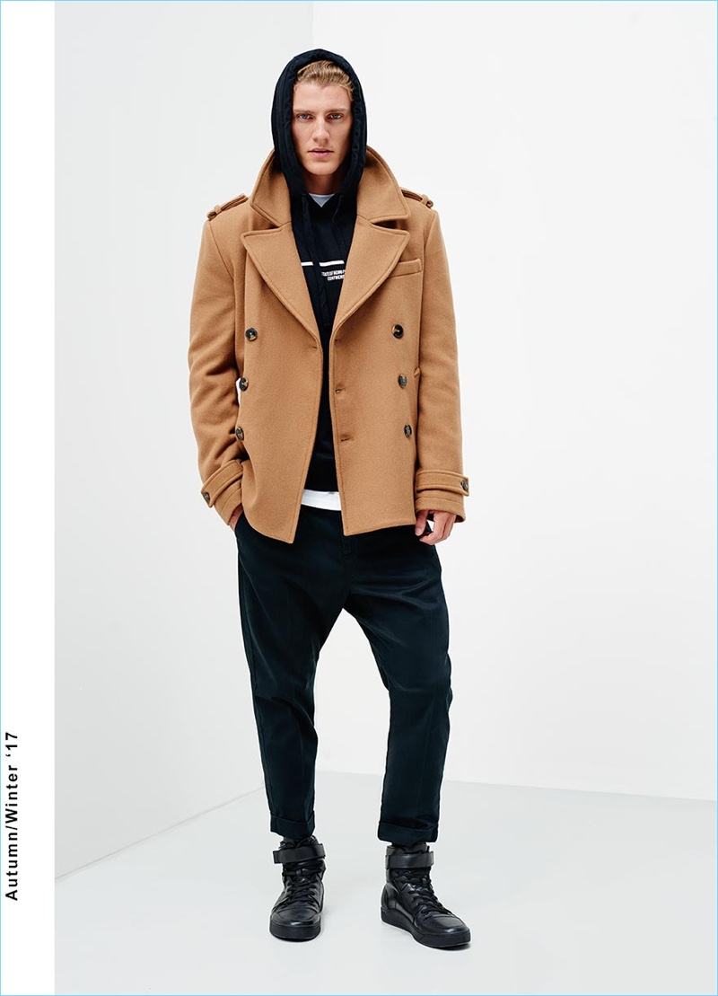A trendy vision, Mikkel Jensen sports drop crotch pants with a short double-breasted jacket and hoodie.