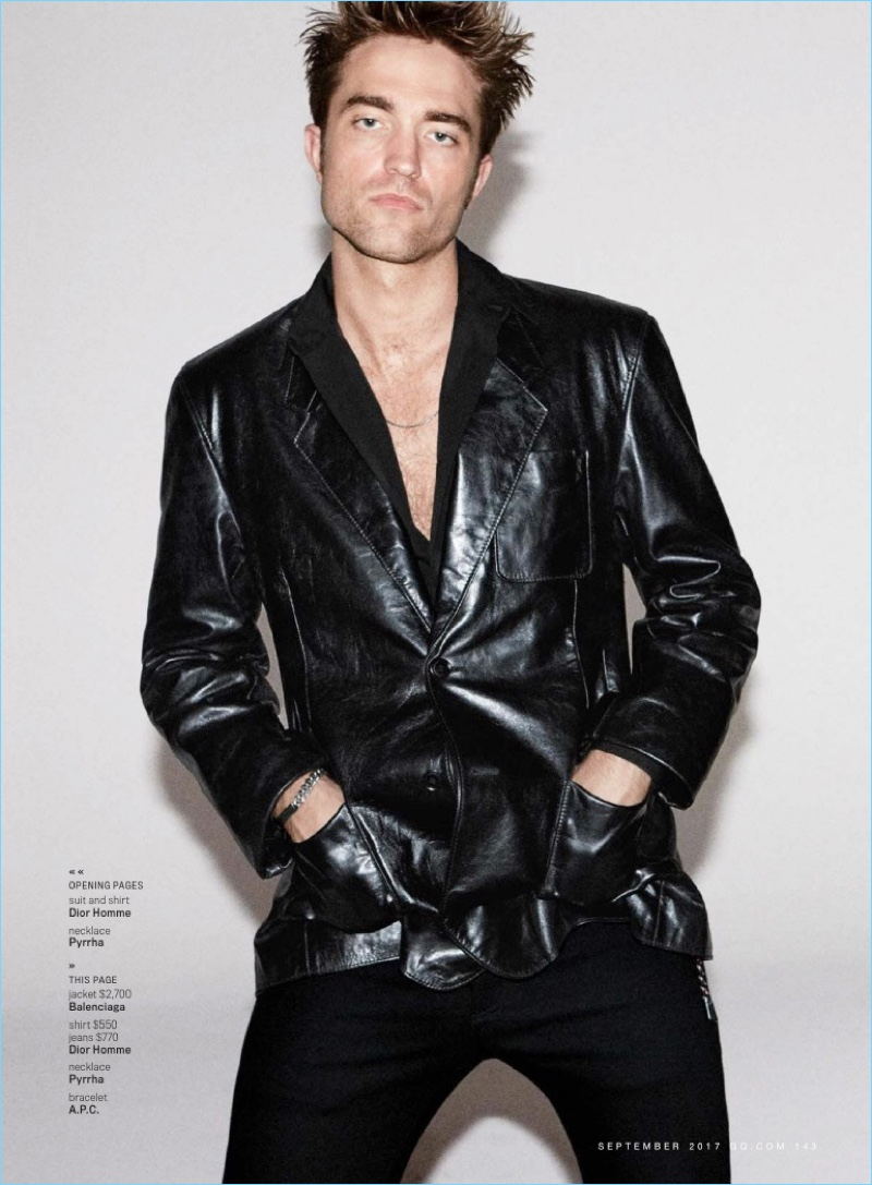 Rocking a Balenciaga leather jacket, Robert Pattinson also wears a shirt and jeans by Dior Homme.
