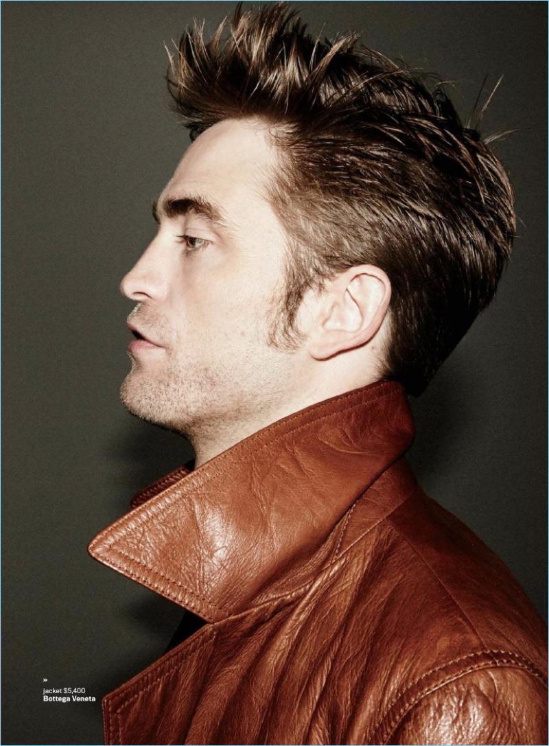 Delivering a side profile, Robert Pattinson dons a Bottega Veneta leather jacket.