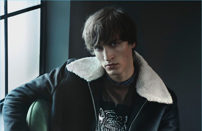 Rocking a shearling collared jacket, Tim Dibble fronts Tiger of Sweden's fall-winter 2017 campaign.