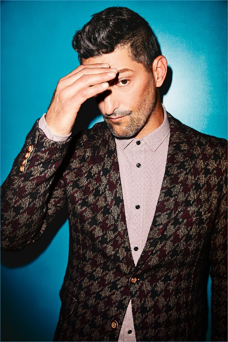 Tony Ward rocks a houndstooth jacket by Mulish with a Scotch & Soda shirt.