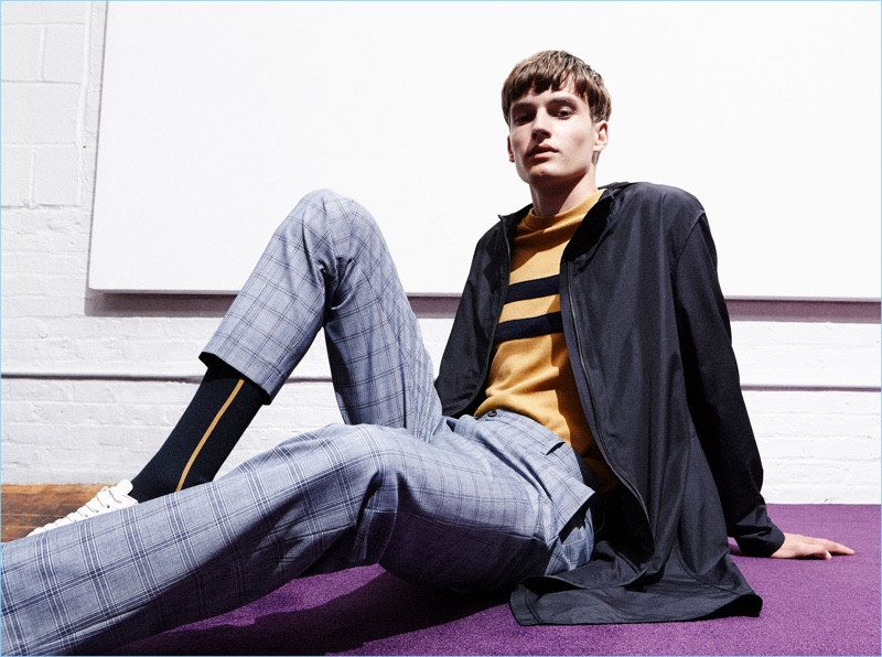 Check trousers come together with a trench coat from Zara Man's sustainable collection.