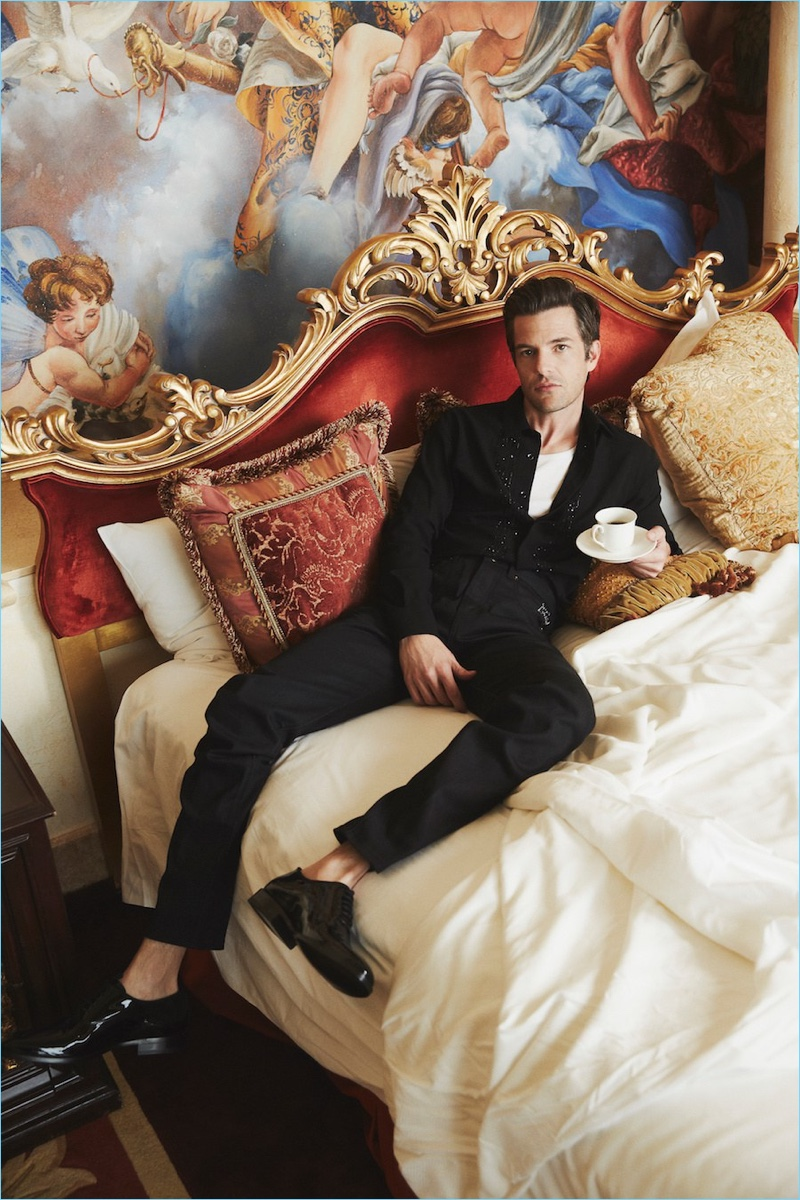 Relaxing in bed, Brandon Flowers wears a black look by Saint Laurent with a Hanes tank.