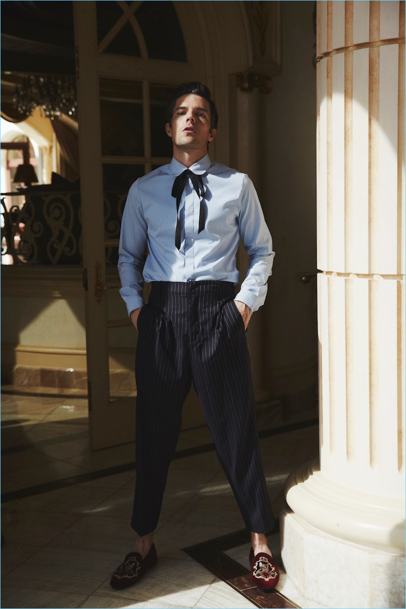 Sporting Dolce & Gabbana shoes, Brandon Flowers dons a shirt and tie by Gucci with 3.1 Phillip Lim trousers.