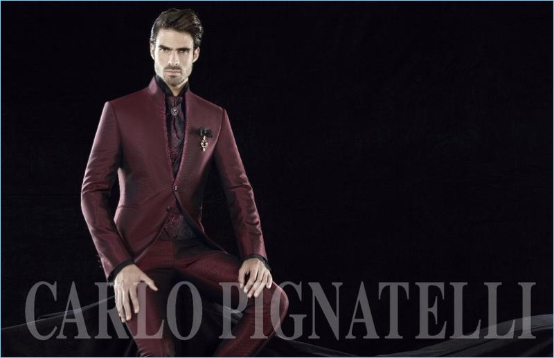 Donning a sartorial burgundy number, Juan Betancourt connects with Carlo Pignatelli Cerimonia.