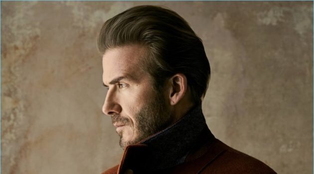 Delivering a side profile, David Beckham dons an Ermenegildo Zegna Couture coat.