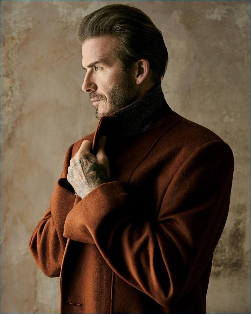 Delivering a side profile, David Beckham dons an Ermenegildo Zegna Couture coat.