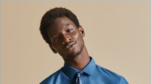 Adonis Bosso wears a smart shirt and tie for Express' fall-winter 2017 campaign.