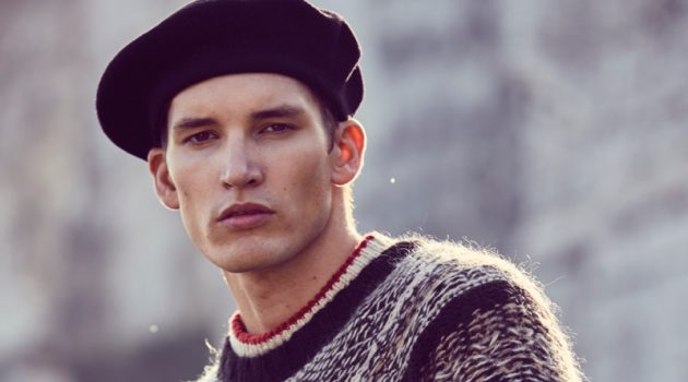 Dominik wears red/white sweater (underneath) Tom Tailor, knit Weekday, pants Jacob Cohen, and beret Loevenich.