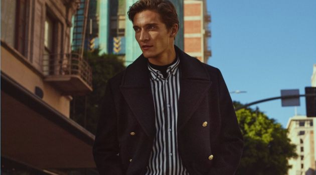 Matvey Lykov dons a peacoat with a striped shirt for H&M's fall 2017 campaign.