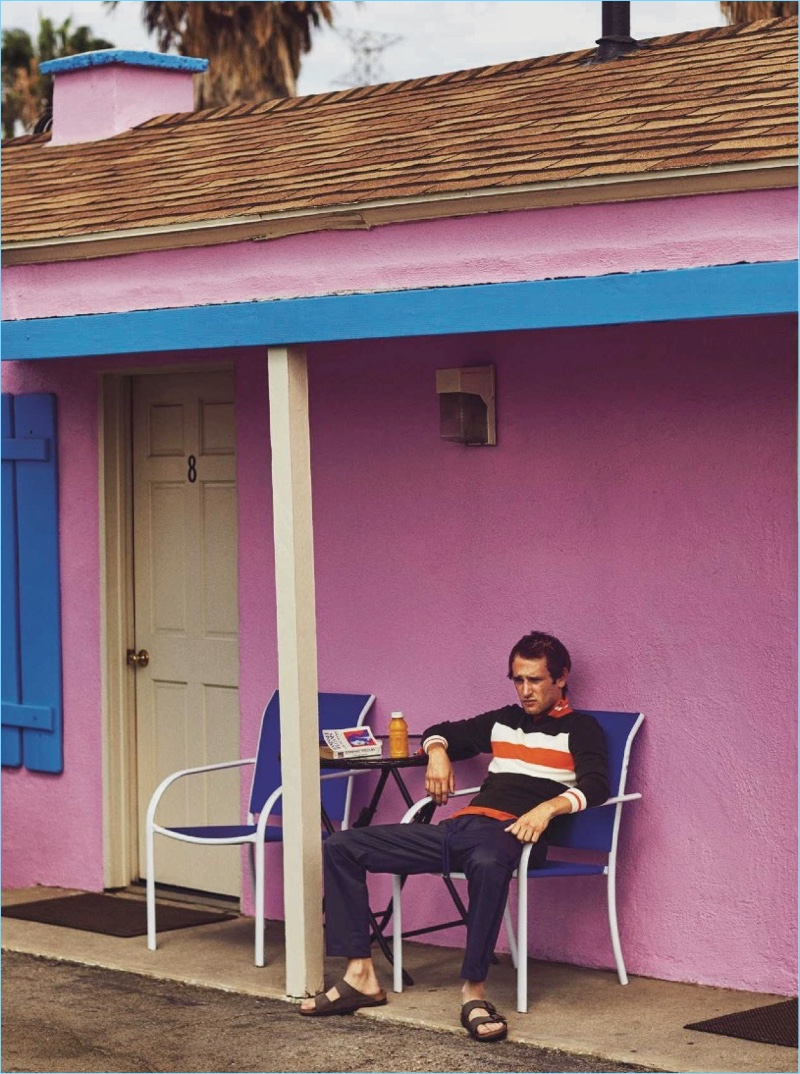 Relaxing, Hopper Penn dons a Fendi track jacket with Dolce & Gabbana joggers and Birkenstocks sandals.