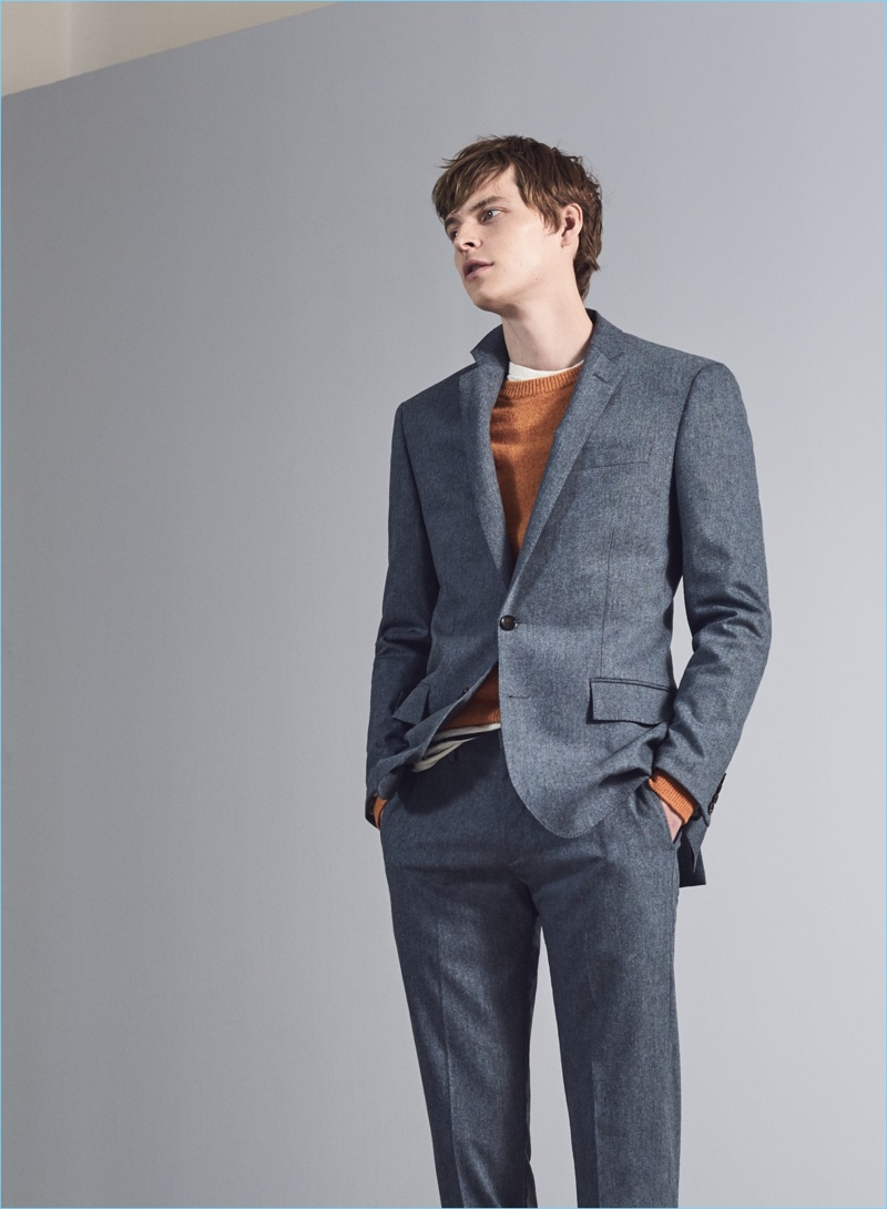 A Suit That Multitasks: John Hein dons a Ludlow slim suit jacket $425 and pants $225. He also wears a J.Crew lambswool sweater $69.50 and striped t-shirt $45.