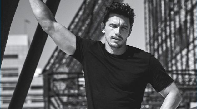 Taking to a roof top, James Franco wears a Giorgio Armani t-shirt with Fabric Brand & Co. denim jeans.