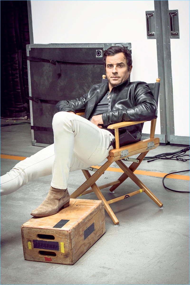 Relaxing, Justin Theroux wears a Ajmone leather jacket with a vintage t-shirt, G-Star jeans, and his own boots.