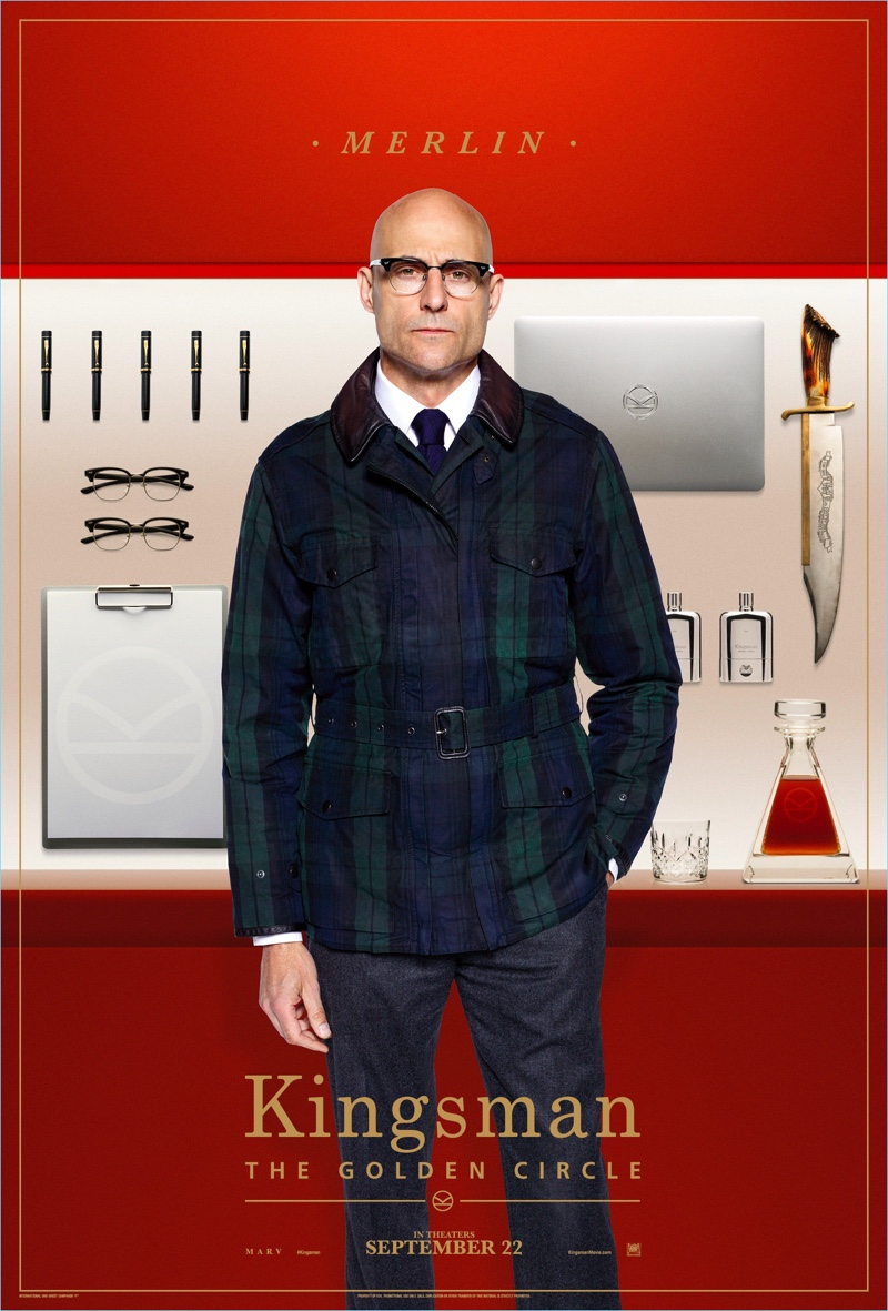 Mark Strong dons a Kingsman + Mackintosh plaid field jacket $830 as Merlin. Strong also sports Kingsman + Cutler and Gross square-frame glasses $380 and wool-flannel trousers $595.
