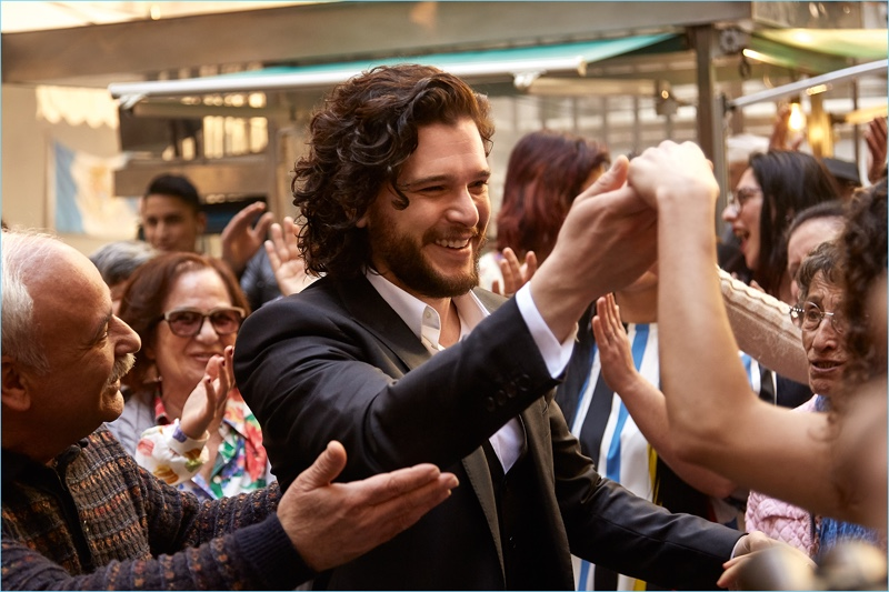 All smiles, Kit Harington films the campaign for Dolce & Gabbana's fragrance, The One.