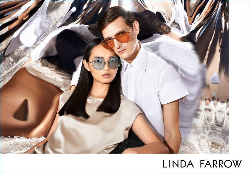 Models Ling Ling and Yannick Abrath embrace for Linda Farrow's fall-winter 2017 campaign.