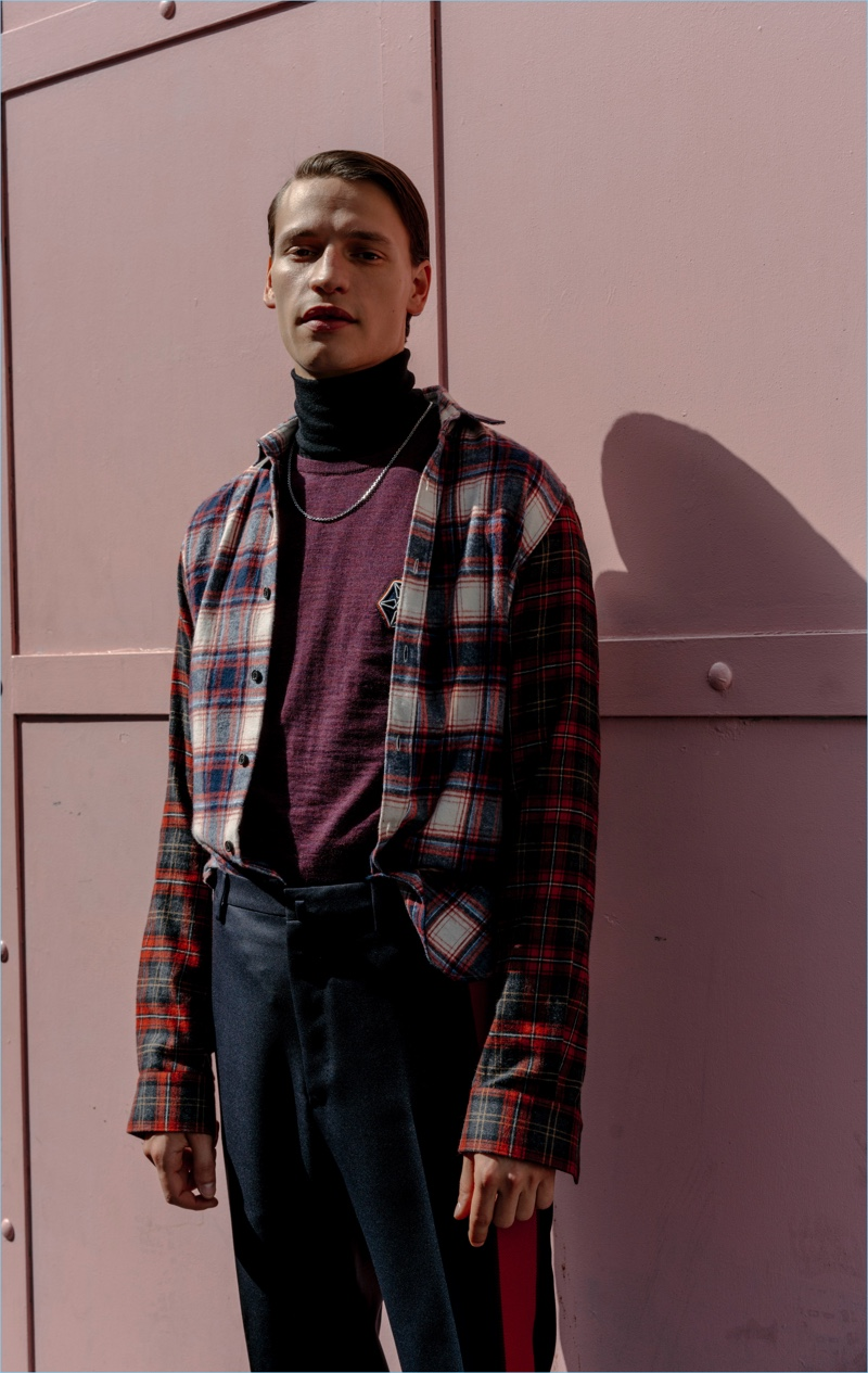 Subscribe to Lanvin's fall style narrative with a contrast-sleeve checked shirt $435. Complete the look with a wool sweater $375 and side-striped trousers $520.
